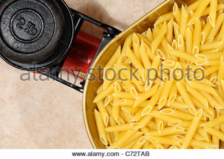 Dry pasta on Kitchen scales, England - Stock Photo