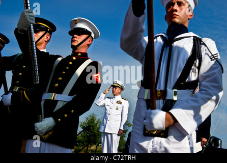U.S. Navy Adm. Mike Mullen, chairman of the Joint Chiefs of Staff renders honors during the playing of the National - Stock Photo
