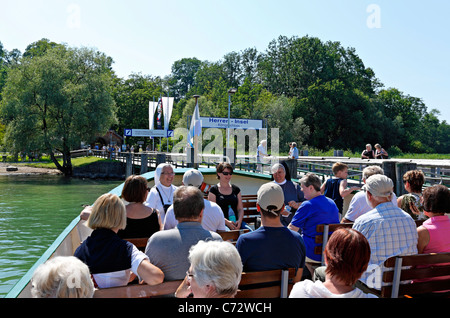 Passengers on a Chiemsee Ferry Boat with the herreninsel Pier in the back ground, Herreninsel Upper Bavaria Germany - Stock Photo