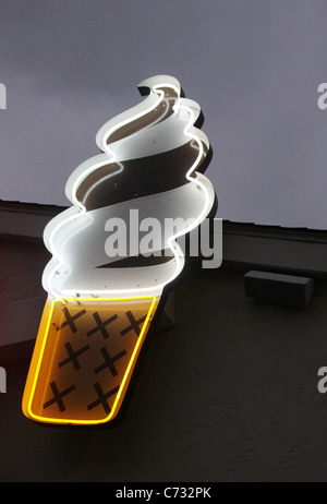 A neon sign in the shape of an ice cream cone. - Stock Photo