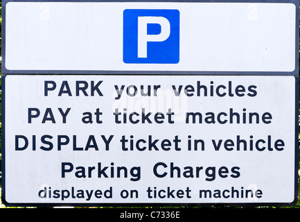 Sign by a ticket machine in a Pay and Display car park in Inverness, Highland, Scotland, UK - Stock Photo