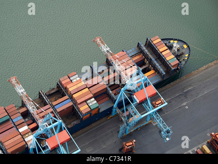 Container Ship Loading at Liverpool Docks, Liverpool, North West England - Stock Photo