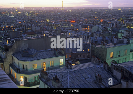 View over roofs of Paris onto the Eiffel Tower in the evening, Montmartre, Paris, France, Europe - Stock Photo