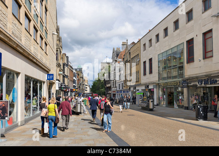 Shops on Cornmarket Street in the city centre, Oxford, Oxfordshire, England, UK - Stock Photo