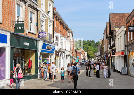 Shops on the High Street in the city centre, Winchester, Hampshire, England, UK - Stock Photo
