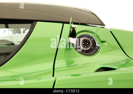 Green Tesla sports car charging point - Stock Photo