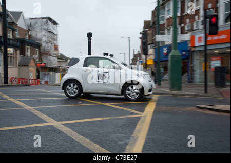 A smart car with a box junction camera on the roof preventing cars from blocking the box. - Stock Photo