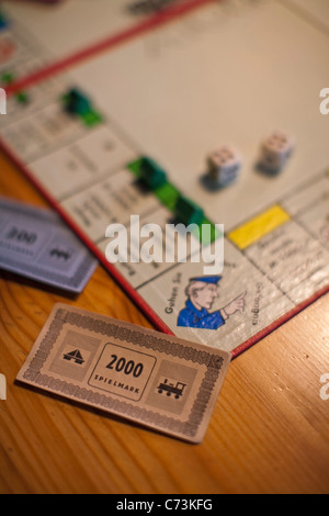 monopoly board game, German version, detail, blurred, play money, Germany - Stock Photo