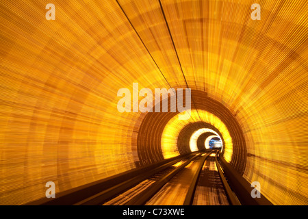 Blurred motion light trails in an train tunnel under the Huangpu tiver linking the Bund to Pudong, Shanghai, China - Stock Photo