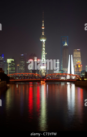 New Pudong skyline Waibaidu (Garden) Bridge looking across the Huangpu River from the Bund Shanghai China - Stock Photo