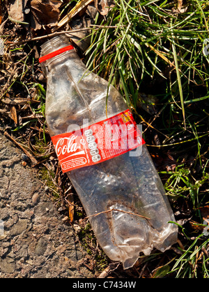 Plastic Coca Cola bottle discarded and left in the countryside in Britain - Stock Photo