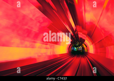 Blurred motion light trails in an train tunnel under the Huangpu River linking the Bund to Pudong, Shanghai, China - Stock Photo