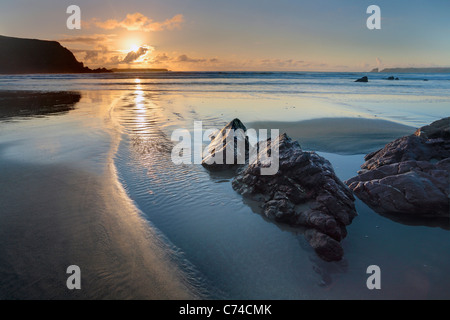 Sunset over Albion Sands in Pembrokeshire, Wales - Stock Photo