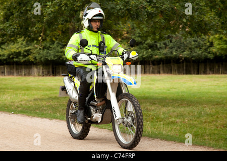 A police office on a motocross scrambler off road police bike in a park in Nottingham England UK - Stock Photo
