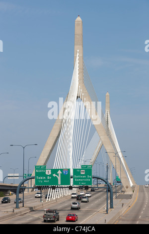 The Leonard P. Zakim Bunker Hill Memorial Bridge carries I-93 and US Route 1 traffic over the Charles RIver in Boston, - Stock Photo