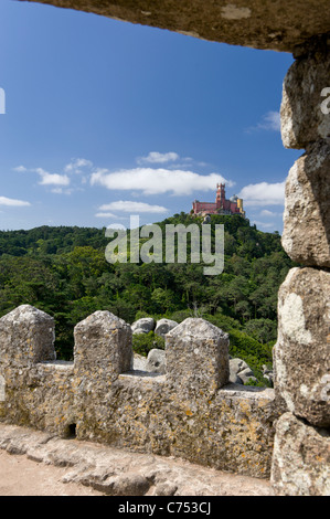 Portugal Sintra, Pena Palace seen from the Castelo dos Mouros castle ramparts - Stock Photo