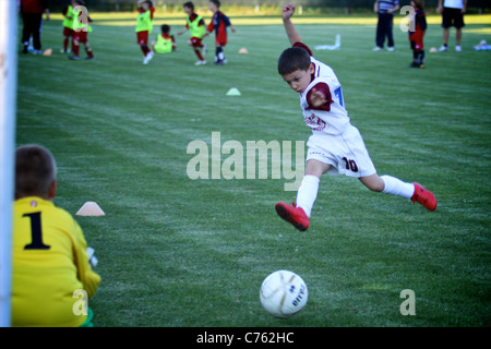 Goalkeeper ready to kick the soccer ball in the ground Stock