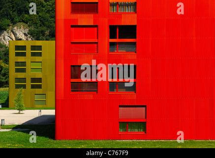 Colourful apartement buildings in the housing estate Les Iles, St-Maurice, Valais, Switzerland - Stock Photo