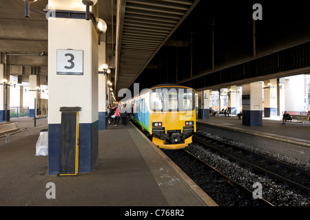Passengers boarding the train in Birmingham Snow Hill railway station, England, UK - Stock Photo
