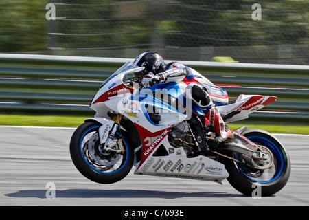 ZELTWEG, AUSTRIA - AUGUST 20 Marc Wildisen (#4, Germany) competes in the IDM Superbike cupon August 20, 2011 - Stock Photo