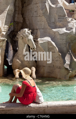 Tourists cooling and paddling in the Piazza Navona Fountains in Rome Italy - Stock Photo