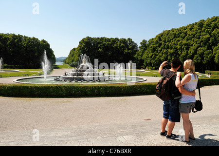 Man and Woman making a self portrait photo in front of the Latona Fountain, Herrenchiemsee Herreninsel Upper Bavaria - Stock Photo