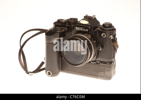 an old well used classic Nikon FE2 with motordrive, Classic camera, studio photo - Stock Photo