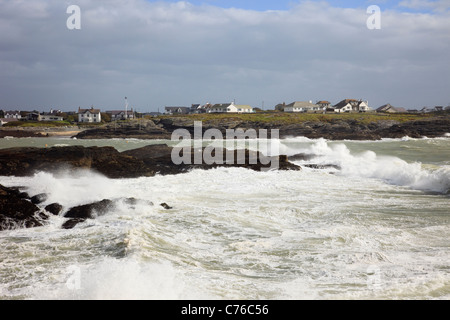 Trearddur Bay, Anglesey, North Wales, UK. View across rough stormy sea with waves crashing on rocks on exposed west - Stock Photo