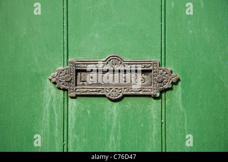 UK, London, Old fashion mail slot on wooden green doors - Stock Photo