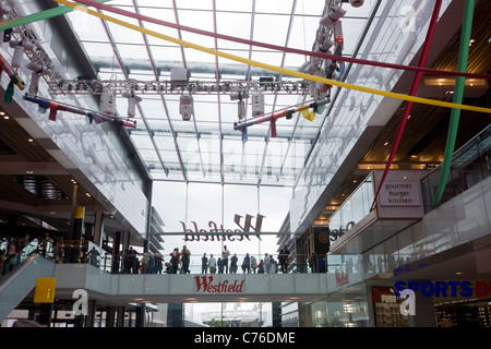 Crowds flock to the newly-opened Westfield Stratford City shopping centre, a centerpiece of the 2012 London Olympics. - Stock Photo