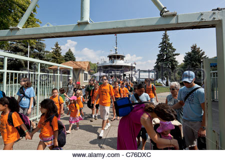 Day trippers leaving the ferry and arriving at the Toronto Islands Park at Toronto Ontario Canada - Stock Photo