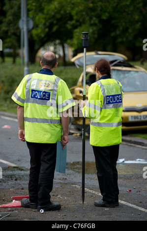 Essex Police Serious Collision Investigation Unit officers investigating a serious collision between fire engine - Stock Photo