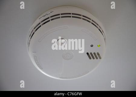 A domestic smoke detector, England - Stock Photo