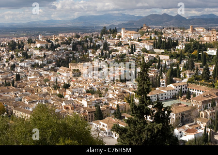 Aerial view of Granada from La  Alhambra. Albayzin  neighborhood  and Sierra Nevada in the background. - Stock Photo