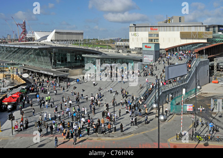 View from above people in busy street scene Stratford train station & Westfield Shopping Centre with London 2012 - Stock Photo