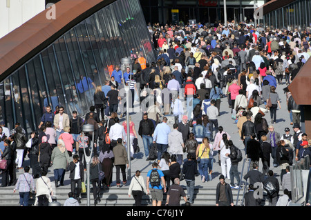 Crowds at Westfield Shopping Centre main entrance on wide footbridge above Stratford station to malls shortly after - Stock Photo