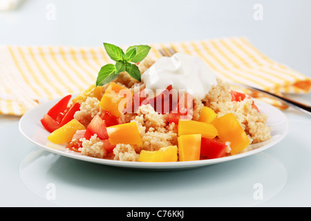 Couscous with fresh tomato and yellow pepper - Stock Photo