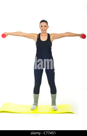 Young woman in black sport suit lifting red barbell - Stock Photo