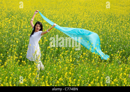 Woman enjoying herself in a field - Stock Photo