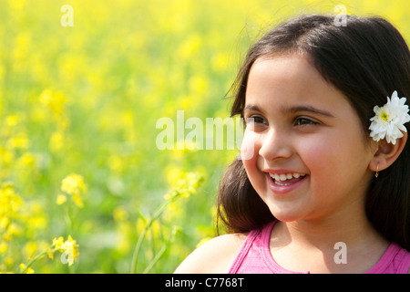 Young girl with a flower in her hair - Stock Photo
