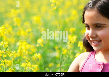 A young girl in a field - Stock Photo