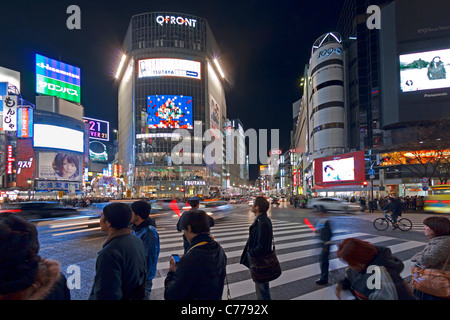 Asia, Japan, Tokyo, Shibuya, Shibuya Crossing - crowds of people crossing the famous intersection - Stock Photo