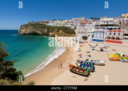 Portugal, the Algarve, Praia do Carvoeiro town and beach with fishing boats - Stock Photo