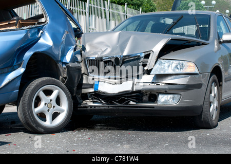 Two cars crashed. Close up image - Stock Photo
