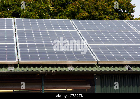 bipv solar panels on roof of cafe building centre for alternative stock photo royalty free. Black Bedroom Furniture Sets. Home Design Ideas