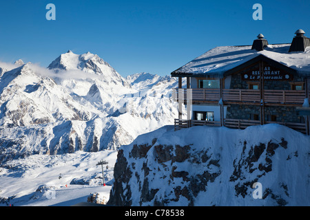 Le Panoramic restaurant with mountains in the background, Courchevel 1850, France. - Stock Photo
