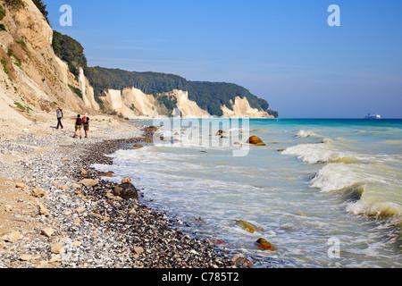 Walkers on beach by Chalk Cliffs, Jasmund National Park, Ruegen, Mecklenburg Vorpommern, Germany - Stock Photo