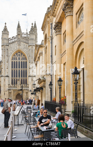 Terrace of the famous Pump Room restaurant at the Roman Baths with the Abbey behind, Bath, Somerset, England, UK - Stock Photo