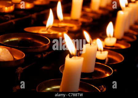 Closeup of rows of prayer candles in a catholic Church - Stock Photo