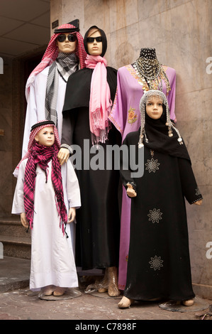 Mannequins dressed in upscale fashion Arab clothing at a store in the Gold Souk district, Dubai, United Arab Emirates. - Stock Photo
